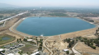 HDA07_34 - 1080 stock footage aerial video approach and fly over the Los Angeles Reservoir, Granada Hills, California