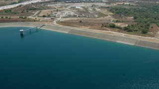 HDA07_35 - 1080 stock footage aerial video fly over Los Angeles Reservoir to police training facility, Granada Hills, California