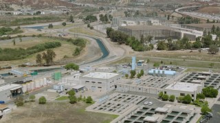 HDA07_37 - 1080 stock footage aerial video fly over water treatment plant to electrical substation in Granada Hills, California