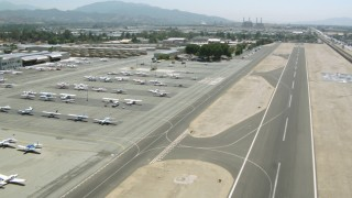 HDA07_44 - 1080 stock footage aerial video of flying over Whiteman Airport, pan to aircraft, Pacoima, California