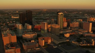 HDA12_002 - 1080 stock footage aerial video of flying by tall skyscrapers at sunset in Downtown Fort Worth, Texas
