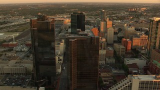 HDA12_004 - 1080 stock footage aerial video of Wells Fargo and DR Horton Tower skyscrapers at sunset, Downtown Fort Worth, Texas