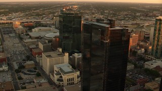HDA12_005 - 1080 aerial stock footage video of flyby by skyscrapers at sunset to reveal high-rise hotel in Downtown Fort Worth, Texas