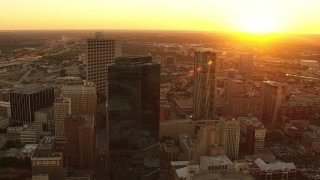 HDA12_007 - 1080 stock footage aerial video flyby skyscrapers with setting sun in distance in Downtown Fort Worth, Texas