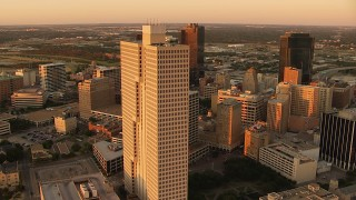 HDA12_010 - 1080 stock footage aerial video of Burnett Plaza and skyscrapers at sunset in Downtown Fort Worth, Texas