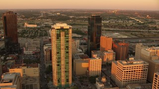 HDA12_011 - 1080 stock footage aerial video of flying by tall skyscrapers at sunset in Downtown Fort Worth, Texas