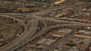 HDA12_012 - 1080 stock footage aerial video of freeway interchanges at sunset, Downtown Fort Worth, Texas