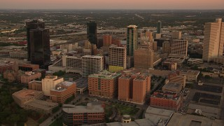 HDA12_014 - 1080 stock footage aerial video of a reverse view of skyscrapers at sunset in Downtown Fort Worth, Texas