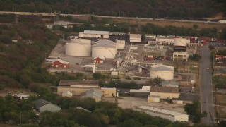 HDA12_015 - 1080 stock footage aerial video of industrial buildings and tanks at sunset in Fort Worth, Texas