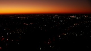 HDA12_018 - 1080 stock footage aerial video of a reverse view of neighborhoods at sunrise in Fort Worth, Texas