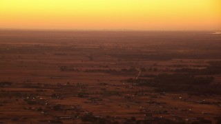 HDA12_024 - 1080 stock footage aerial video of flying by farmland and rural homes at sunrise, Decatur, Texas