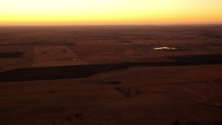 HDA12_025 - 1080 stock footage aerial video of farmland and homes at sunrise, Decatur, Texas