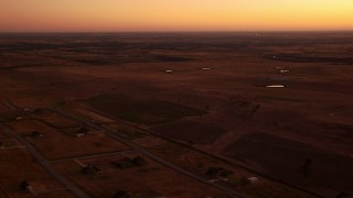 HDA12_026 - 1080 stock footage aerial video of flying by rural homes and farmland at sunrise in Decatur, Texas