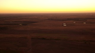 HDA12_027 - 1080 stock footage aerial video pass rural homes and farm fields at sunrise in Decatur, Texas