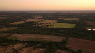 HDA12_031 - 1080 stock footage aerial video of a wide view of farmland at sunrise, Decatur, Texas