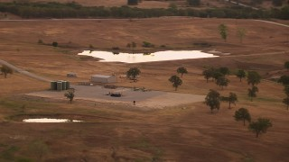 HDA12_035 - 1080 stock footage aerial video of a pond and silos on a farm at sunrise in Decatur, Texas