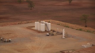 HDA12_036 - 1080 stock footage aerial video of small farm silos at sunrise in Decatur, Texas