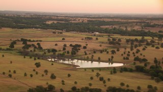 HDA12_037 - 1080 stock footage aerial video of a pond, rural homes and farms at sunrise, Decatur, Texas