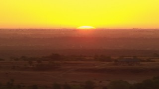 HDA12_039 - 1080 stock footage aerial video of the rising sun behind farm fields in Decatur, Texas