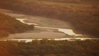 HDA12_054 - 1080 stock footage aerial video of flying by Red River at sunrise, Texas