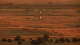 HDA12_056 - 1080 stock footage aerial video of a tower on farmland at sunrise in Oklahoma