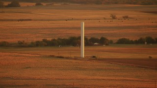 HDA12_057 - 1080 stock footage aerial video of a silo on a farm at sunrise in Oklahoma