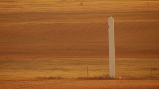 HDA12_059 - 1080 stock footage aerial video of a silo in the middle of a field at sunrise in Oklahoma