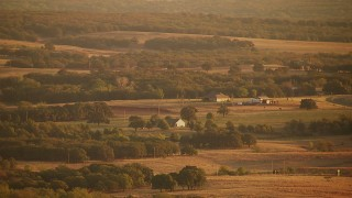 HDA12_065 - 1080 aerial stock footage video flyby farmhouses and fields at sunrise in Comanche Lake, Oklahoma