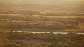 HDA12_066 - 1080 stock footage aerial video of a barn and farmland at sunrise near Comanche Lake, Oklahoma