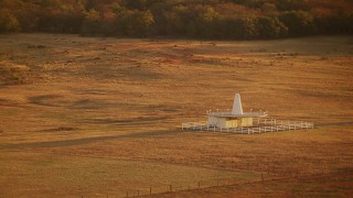 HDA12_068 - 1080 stock footage aerial video of a building in the middle of a field at sunrise in Oklahoma