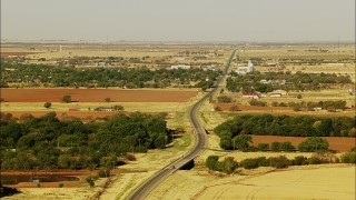 HDA12_080 - 1080 stock footage aerial video of flying by Highway 53 by the town of Walters, Oklahoma