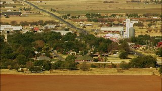 HDA12_081 - 1080 stock footage aerial video of a small town with a highway passing through it in Walters, Oklahoma