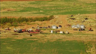 HDA12_085 - 1080 stock footage aerial video of tractors and tanks by fields in Walters, Oklahoma