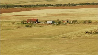 HDA12_086 - 1080 stock footage aerial video approach a farmhouse and barn in Walters, Oklahoma