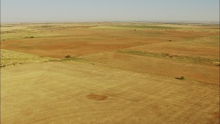 HDA12_087 - 1080 stock footage aerial video pass fields in a vast farm area in Walters, Oklahoma