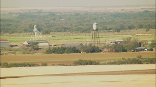 HDA12_089 - 1080 stock footage aerial video of a farm with a water tower in Walters, Oklahoma