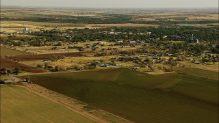 HDA12_095 - 1080 stock footage aerial video of the town of Walters and farm fields in Oklahoma