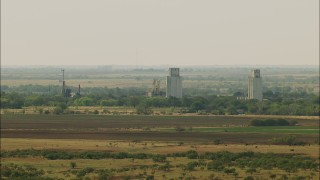 HDA12_098 - 1080 stock footage aerial video of silos and farmland in Temple, Oklahoma
