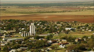 HDA12_103 - 1080 stock footage aerial video of flying over the town toward fields in Temple, Oklahoma
