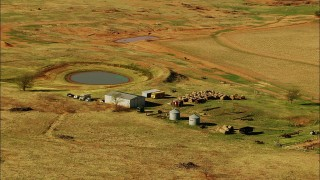 HDA12_104 - 1080 stock footage aerial video of hay bales and pond on a farm in Temple, Oklahoma