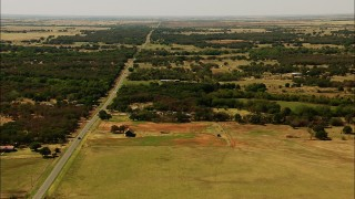 HDA12_105 - 1080 stock footage aerial video flyby country road, rural homes, farmland in Temple, Oklahoma