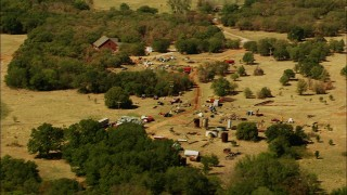 HDA12_106 - 1080 stock footage aerial video of rural home and junkyard in Temple, Oklahoma