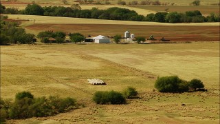 HDA12_107 - 1080 aerial stock footage video of a barn and tractors in Temple, Oklahoma