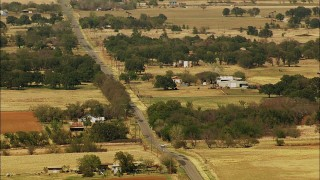 HDA12_108 - 1080 stock footage aerial video of a country road and farms in Temple, Oklahoma