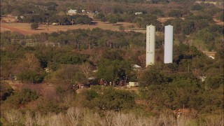 HDA12_123 - 1080 stock footage aerial video of tall silos, rural homes and trees in Meridian, Oklahoma