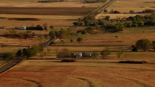 HDA12_128 - 1080 stock footage aerial video of farms and a country road at sunset in Meridian, Oklahoma