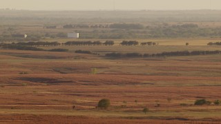 HDA12_130 - 1080 stock footage aerial video of large tanks and farmland at sunset in Oklahoma