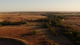 HDA12_133 - 1080 stock footage aerial video of trees, fields and countryside at sunset in Oklahoma