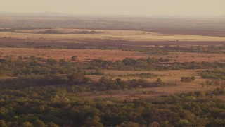 HDA12_139 - 1080 stock footage aerial video of farmland and rural countryside at sunset in Oklahoma