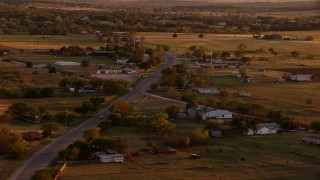 HDA12_149 - 1080 stock footage aerial video of a small rural town at sunset in Nocona, Texas
